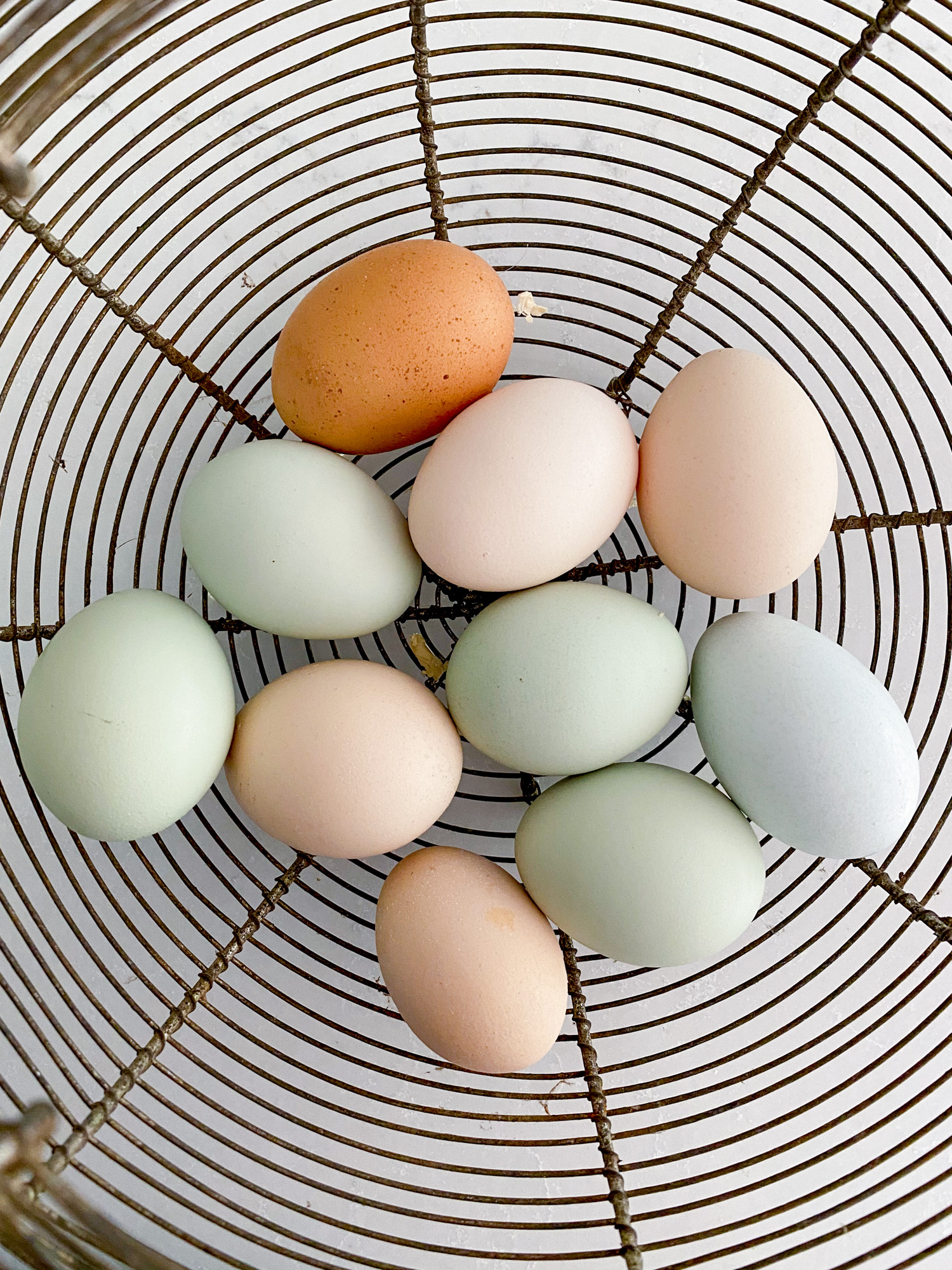 A basket full of perfectly imperfect eggs