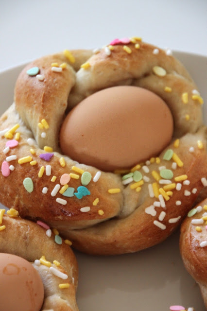 Italian easter bread with cooked egg in the center.