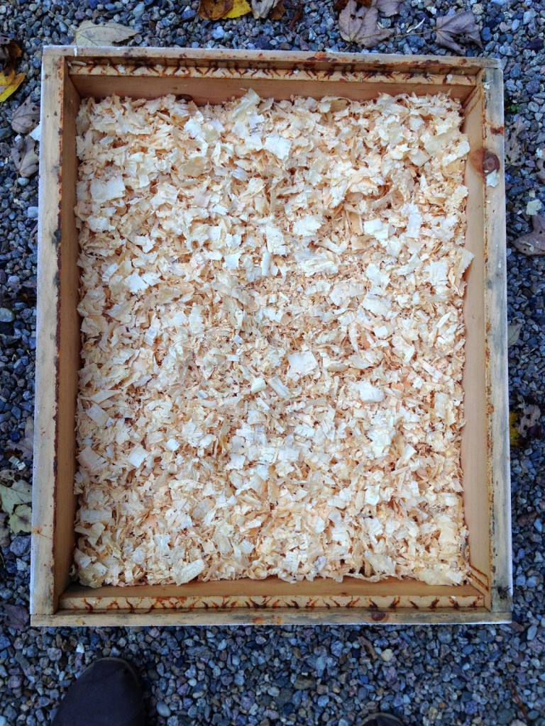 beehive quilting box filled with pine shavings